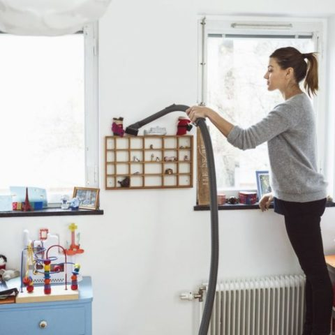woman-vacuuming-small-shelves-in-kids-room-1024x683